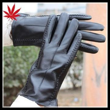 Sexy women wearing genuine sheepskin leather gloves