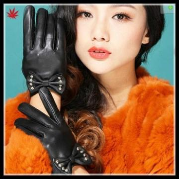 short fingered leather glove with big bow and studs for ladies in black