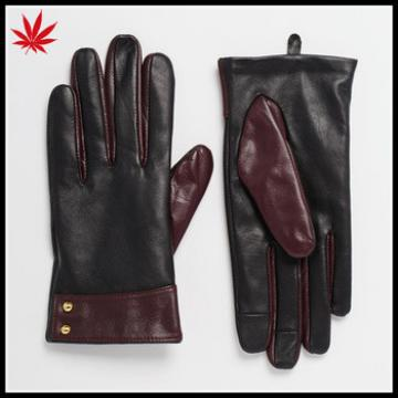 Ladies smart phone wearing leather gloves with cuff detail