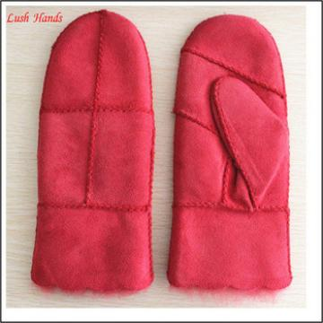 Women Red colour double face mitten leather gloves with visable seam