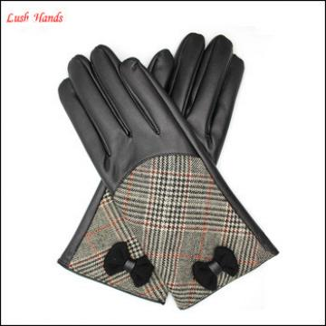 ladies high-quality black leather gloves with checked cloth handback