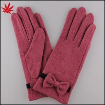 Pink wool gloves with handmade butterfly