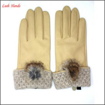 2016 new design yellow leather driving gloves with a fuzzy ball