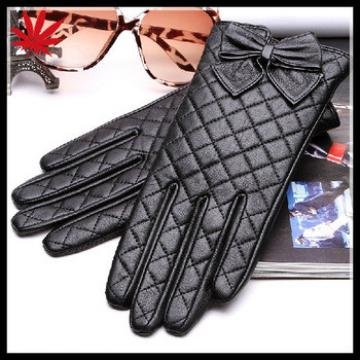 women's quilting seam back leather gloves with bow details