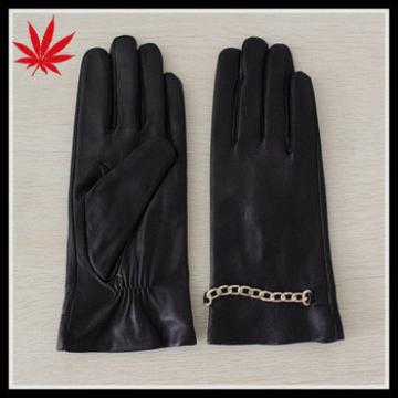 Lady's African leather gloves with metal chains