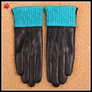 woman putting on leather hand gloves colorful