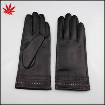 Black leather gloves with many special design stichings at the bottom