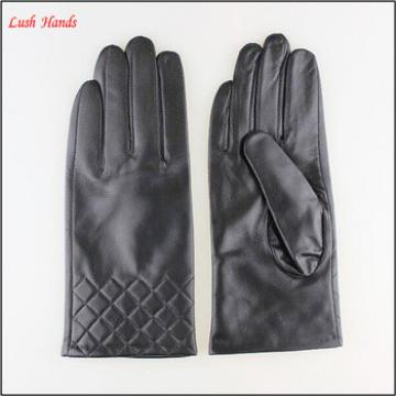 Women's leather gloves with sewings design at bottom