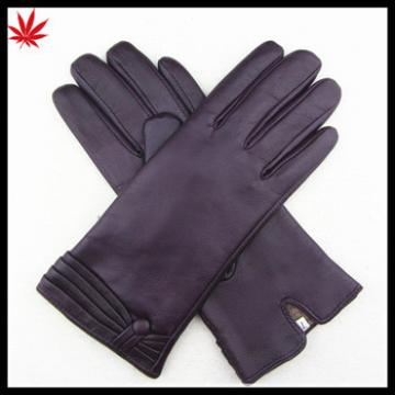 Women's cashmere lined leather gloves with shedding cuff